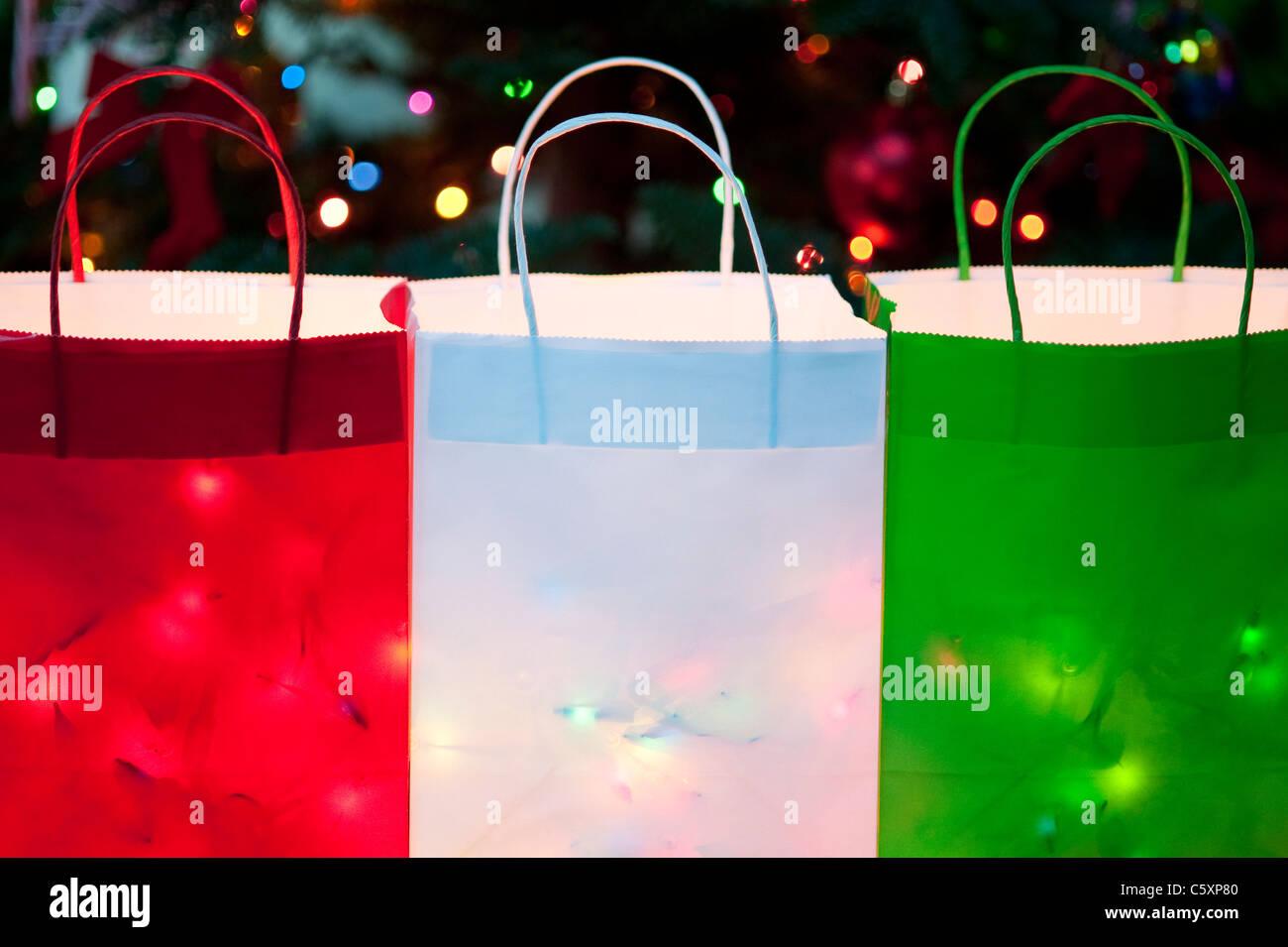 Colorful Christmas bags filled with Christmas Lights - Stock Image