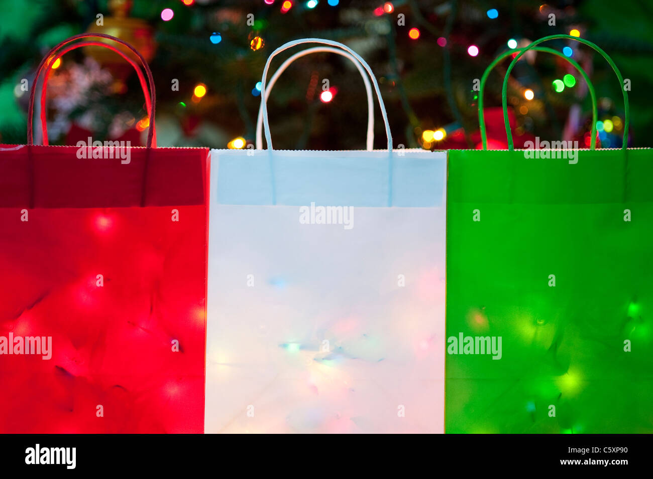 Colorful Christmas bags filled with Christmas Lights Stock Photo