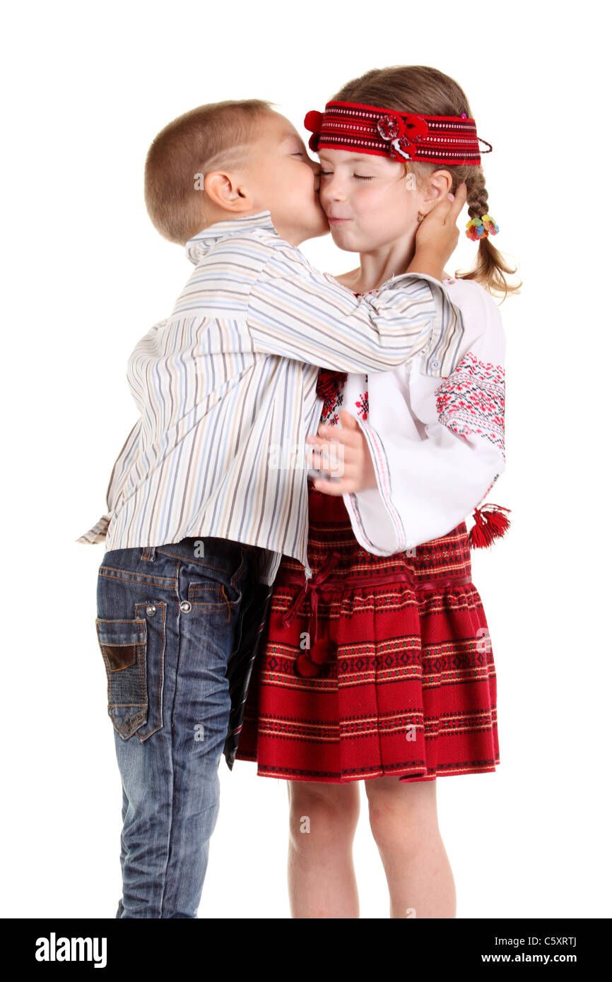 Little boy kissing a little girl on the white background stock photo little boy kissing a little girl on the white background altavistaventures Images
