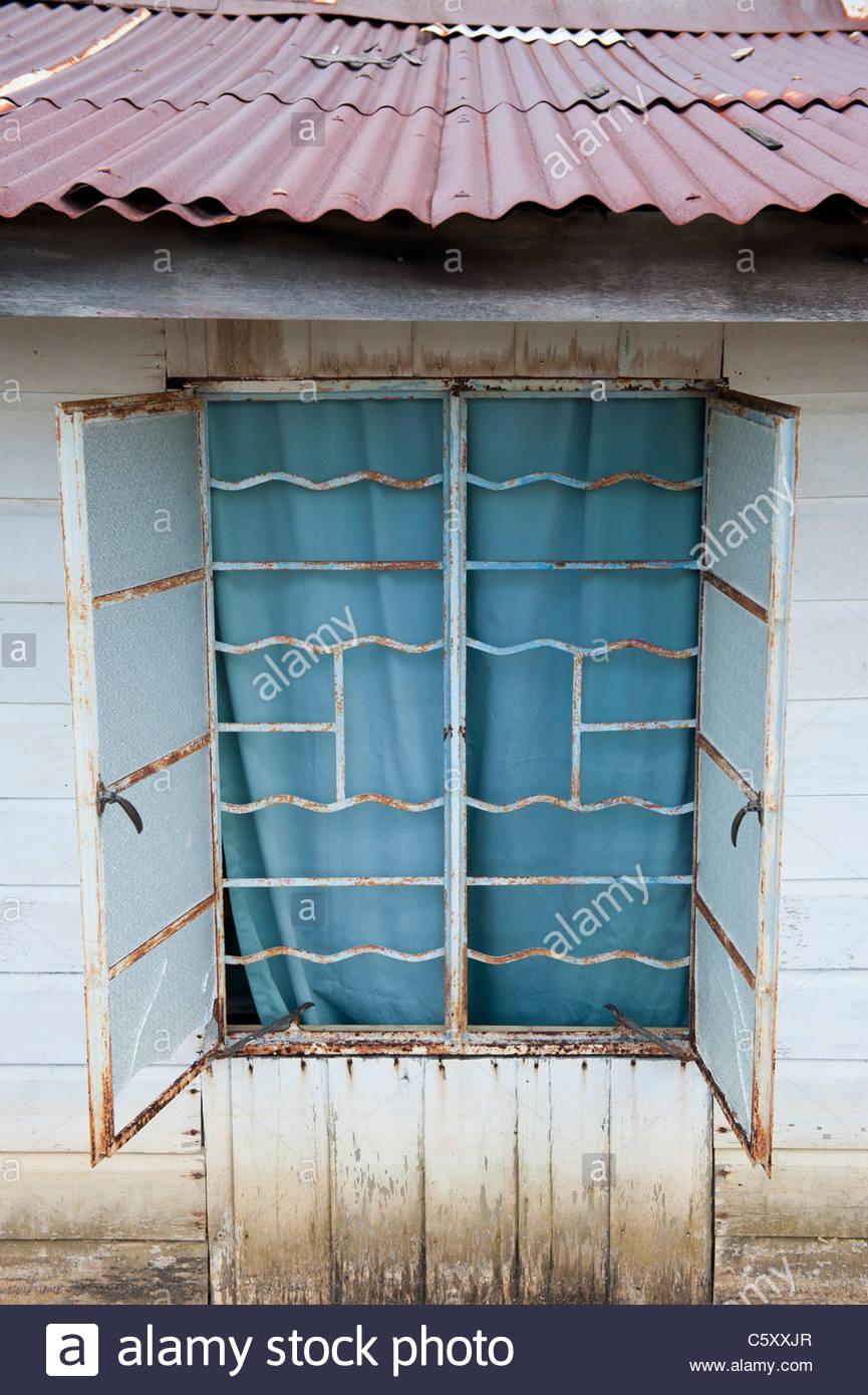 Open Window with Security Bars in Kampong Ayer Water Village in Bandar Seri Begawan, Brunei - Stock Image