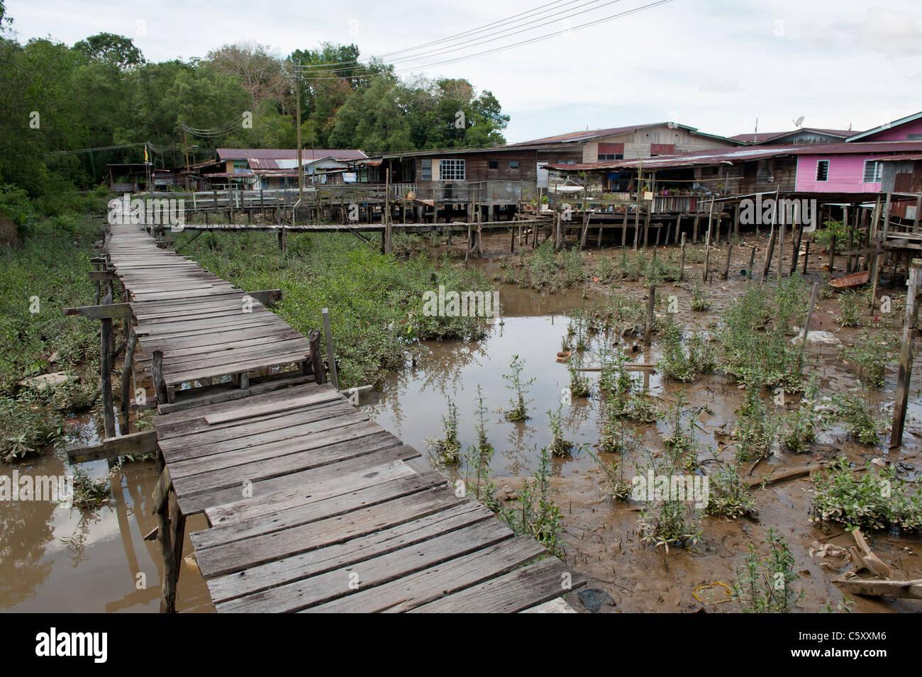 Rickety Walkway in Kampong Ayer Water Village in Bandar Seri Begawan, Brunei - Stock Image