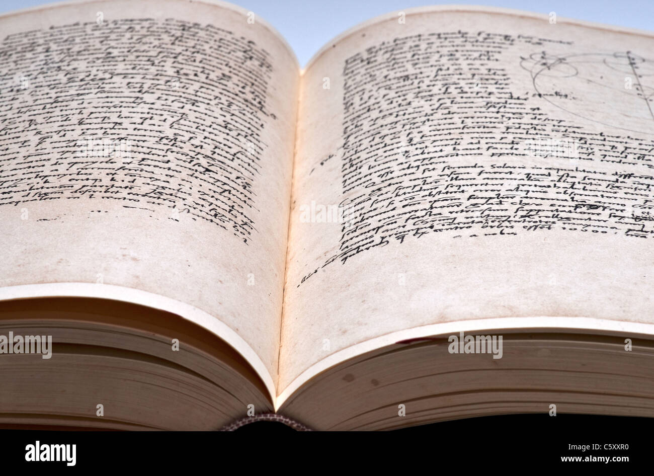 Hand written double-page spread of tattered book - Stock Image