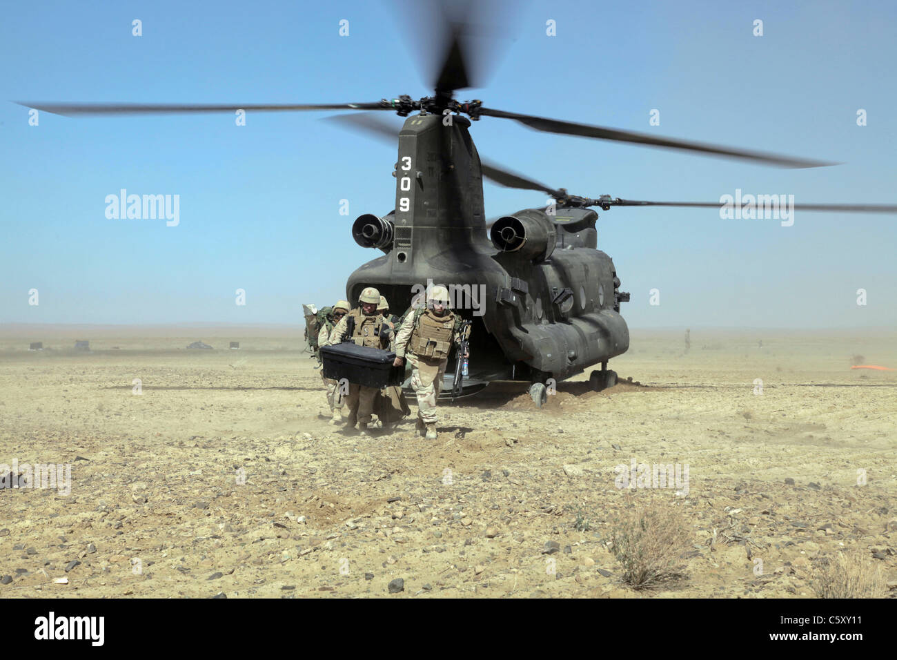 Navy SEABEES depart a CH-47 Chinook helicopter in the Shorabak district, Kandahar province, Afghanistan. - Stock Image