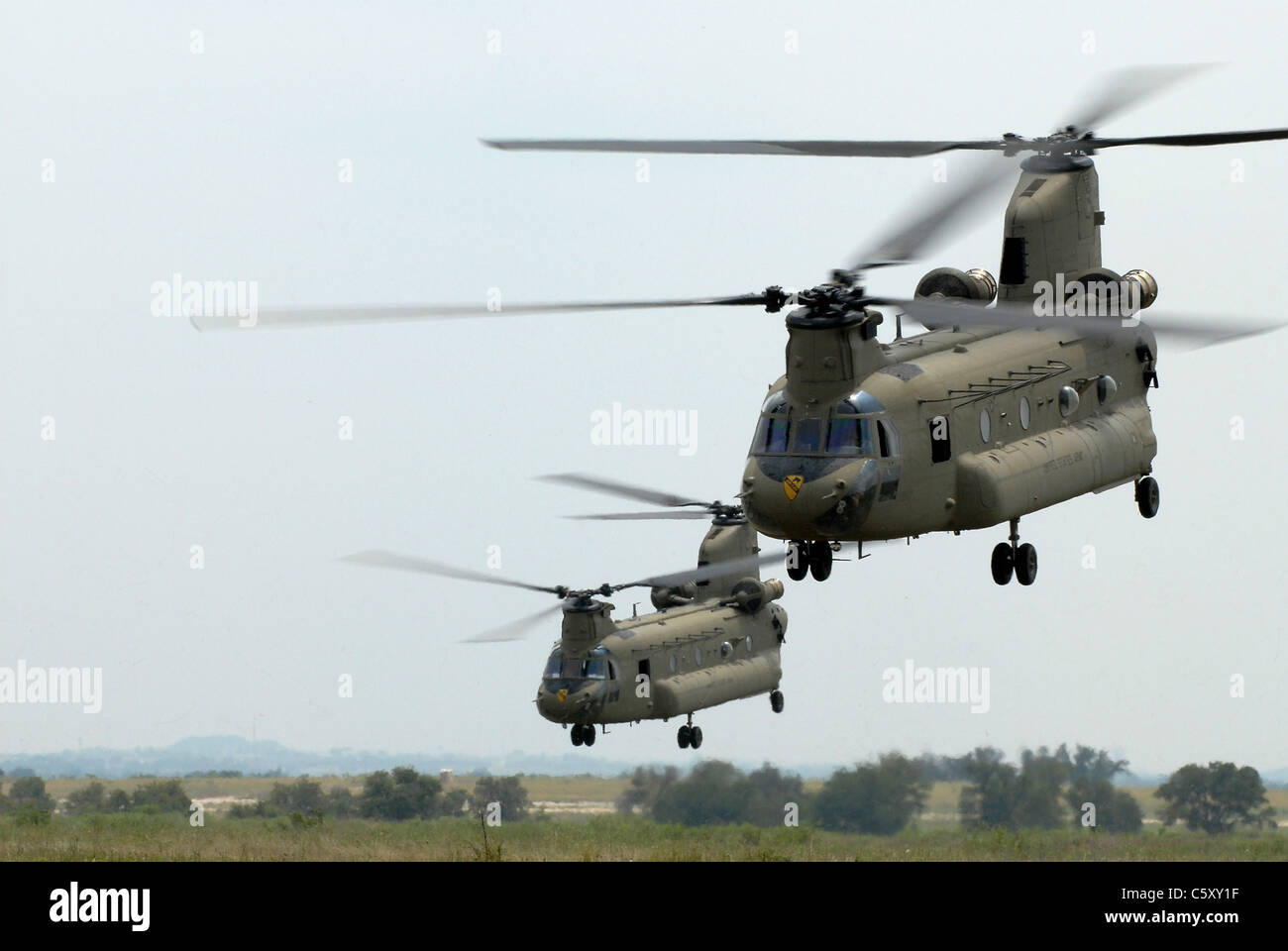 Army CH-47 Chinook helicopters in operation. - Stock Image