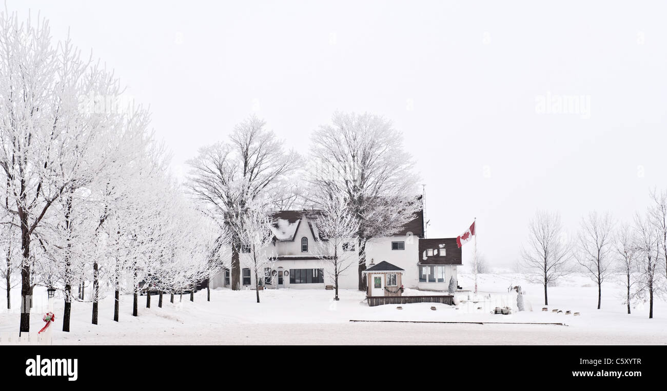 Canadian winter landscape, country side house - Stock Image