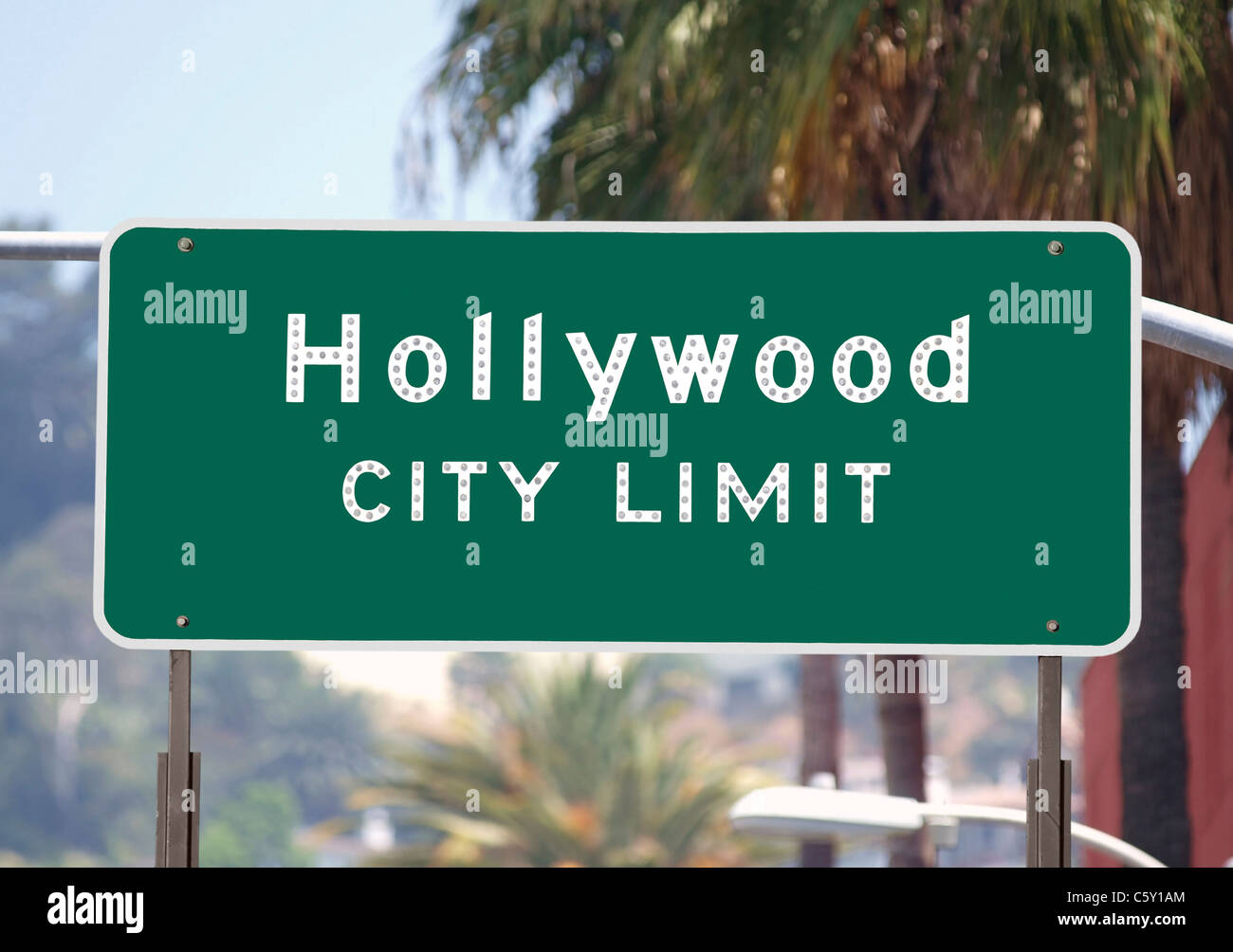 Hollywood city limits sign with palm trees. - Stock Image