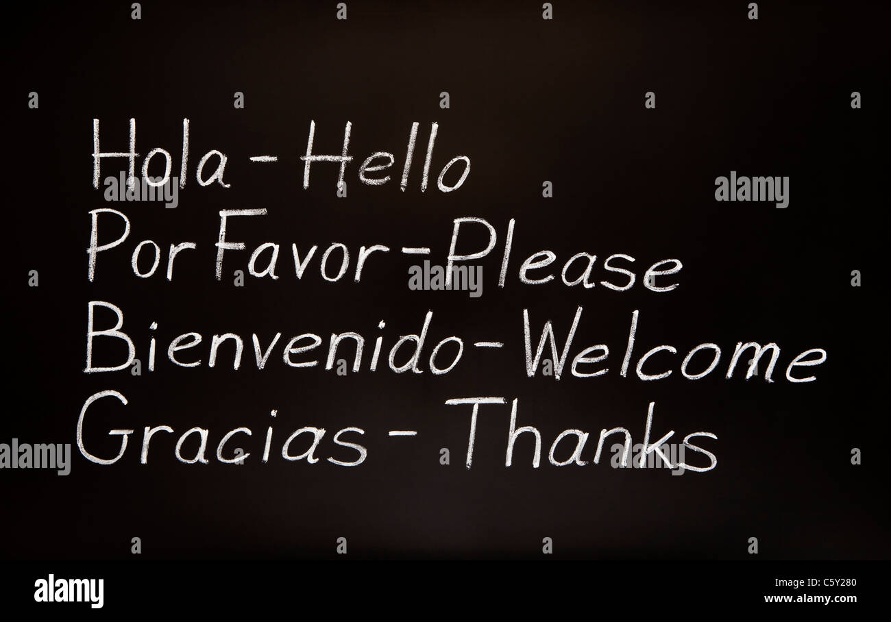 Blackboard with spanish words and their english translations. - Stock Image