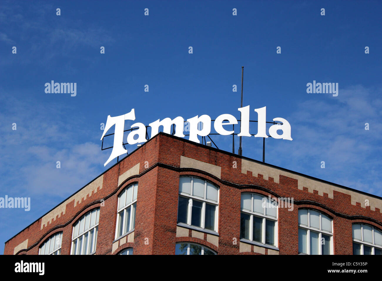 Tampella sign on the roof of their old factory building - Stock Image