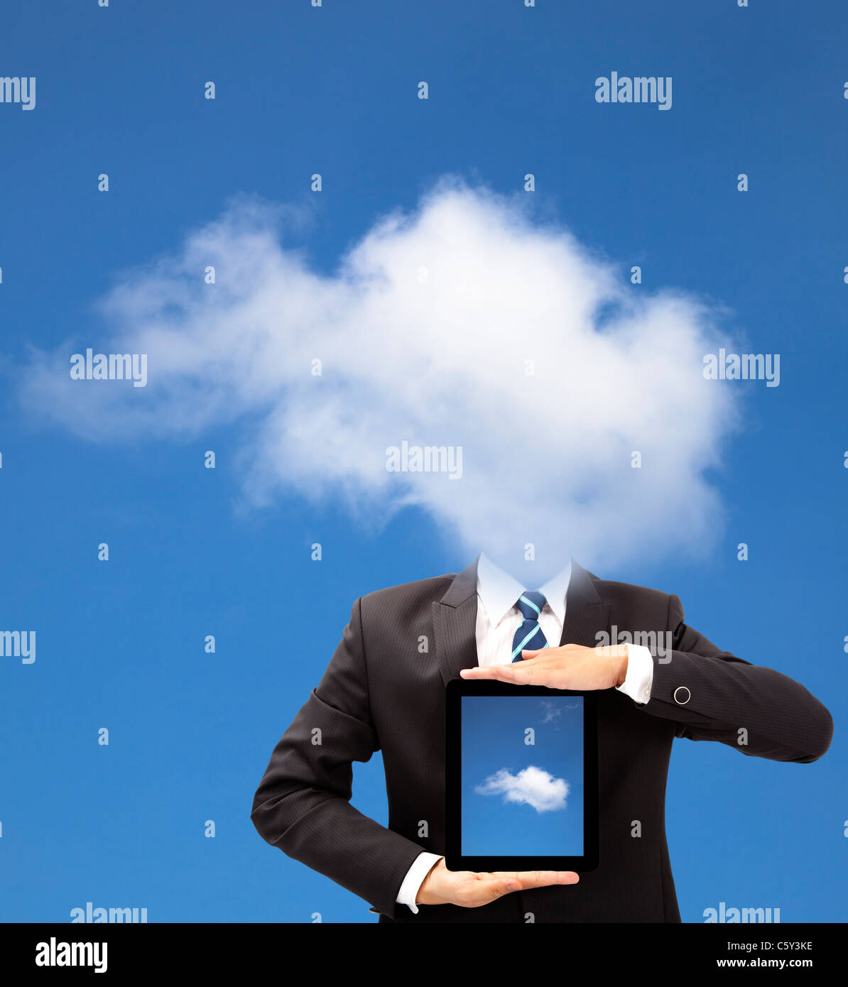 businessman with cloud thinking concept and holding tablet pc - Stock Image