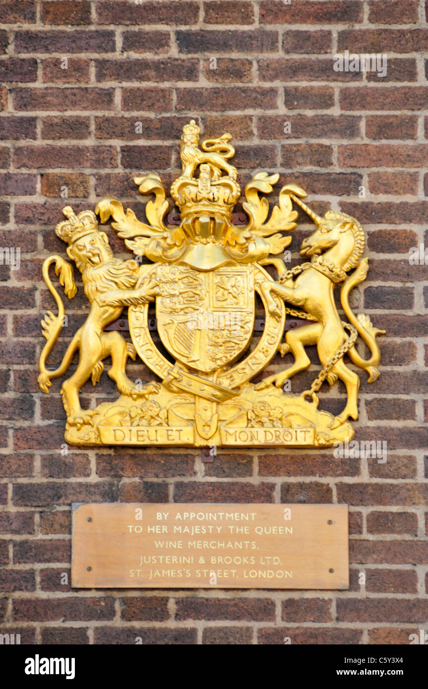 Royal Warrant & Royal coat of arms on premises of wine merchant Justerini & Brooks Ltd business owned by - Stock Image