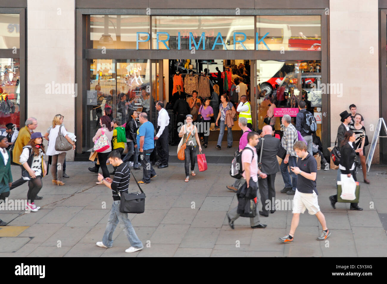 London street scene view from above looking down at shoppers in & around Primark clothing retail shopping store - Stock Image