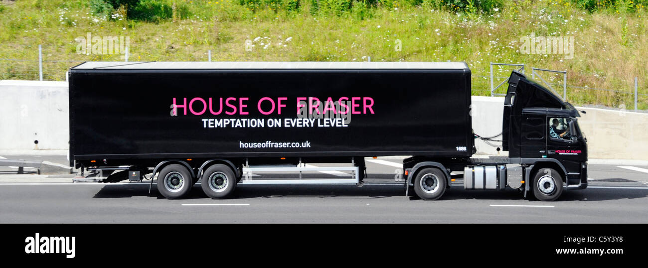 Side view supply chain hgv truck & articulated trailer House of Fraser department store delivery & distribution - Stock Image
