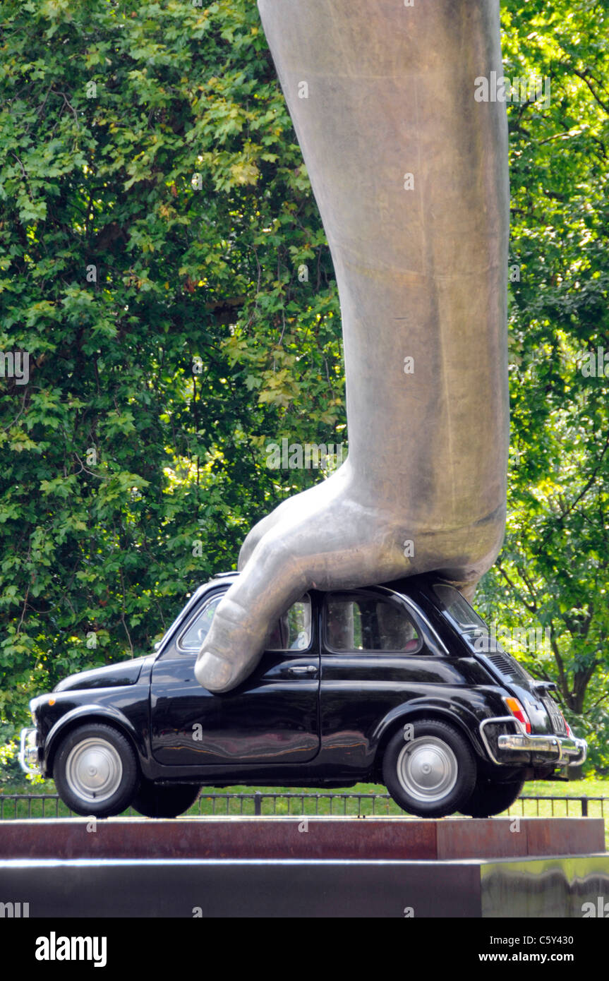"London street scene hand on Fiat car modern art sculpture ""Vroom Vroom"" by Italian artist Lorenzo Quinn middle of Stock Photo"