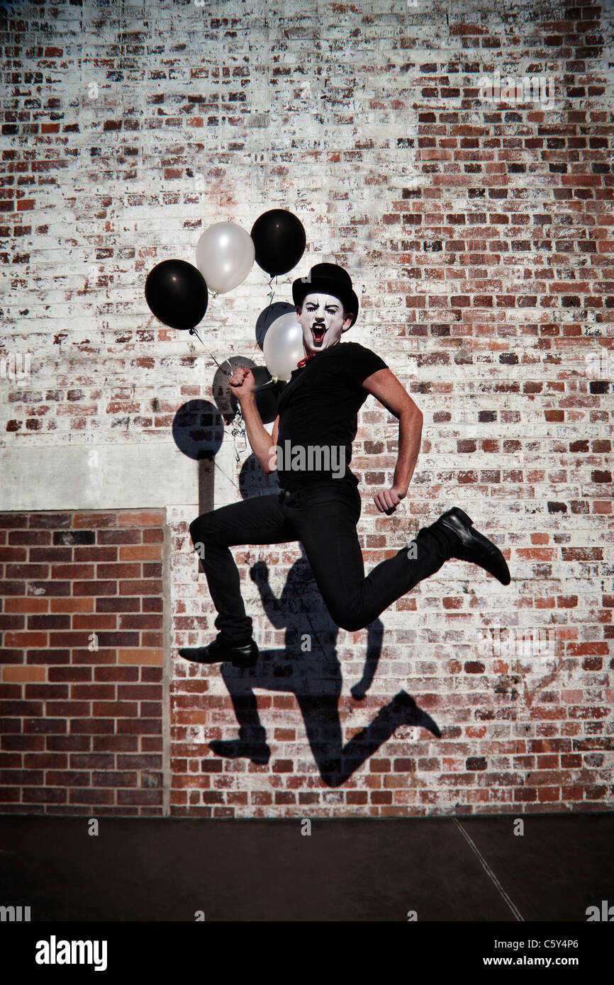 Clown jumping in the air - Stock Image