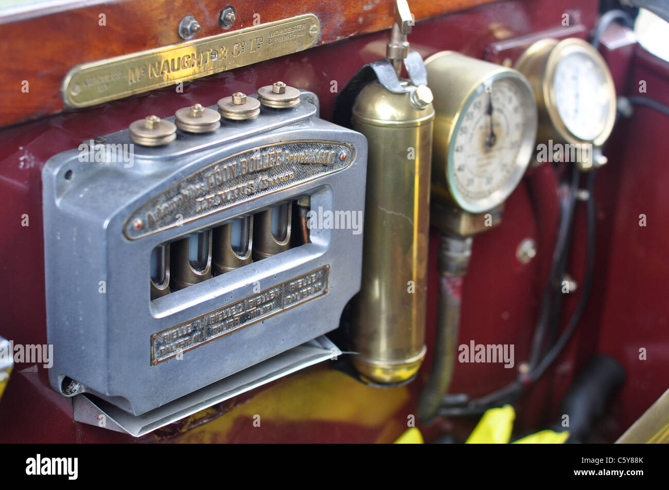 Dash board from a 1910 classic car, various dials and gauges, with a shallow depth of field - Stock Image