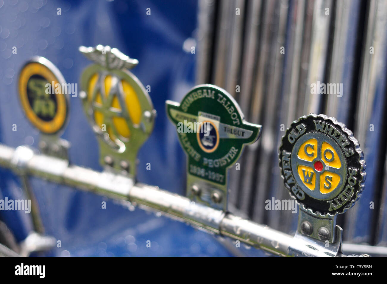 Classic British motoring association badges and emblems fixed to a classic car grill. AA, Sunbeam and Craven Old - Stock Image