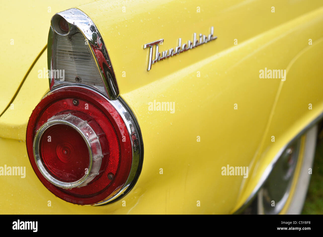 A classic yellow american thunderbird car rear wing fender and light assembly - Stock Image
