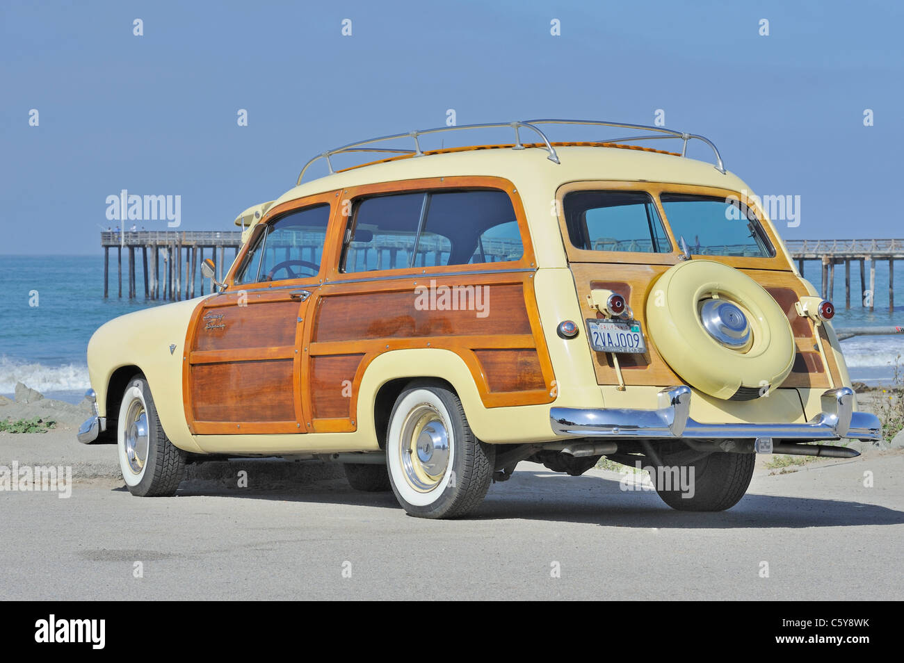 0e5847823a5d96 Classic American ford country squire station wagon car by beach - Stock  Image