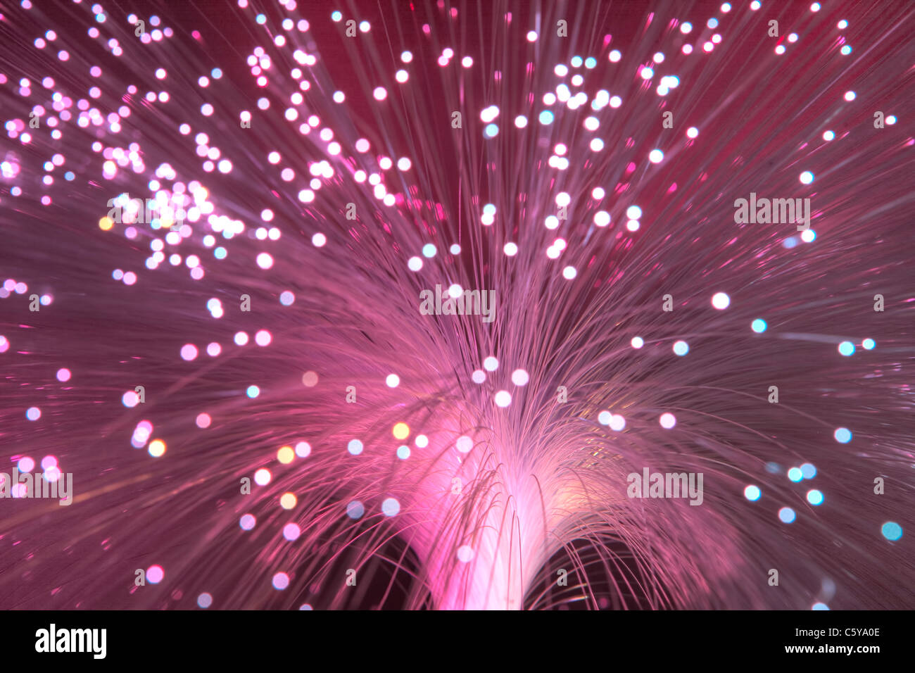 Abstract of multi-coloured fibre optic lamp - Stock Image
