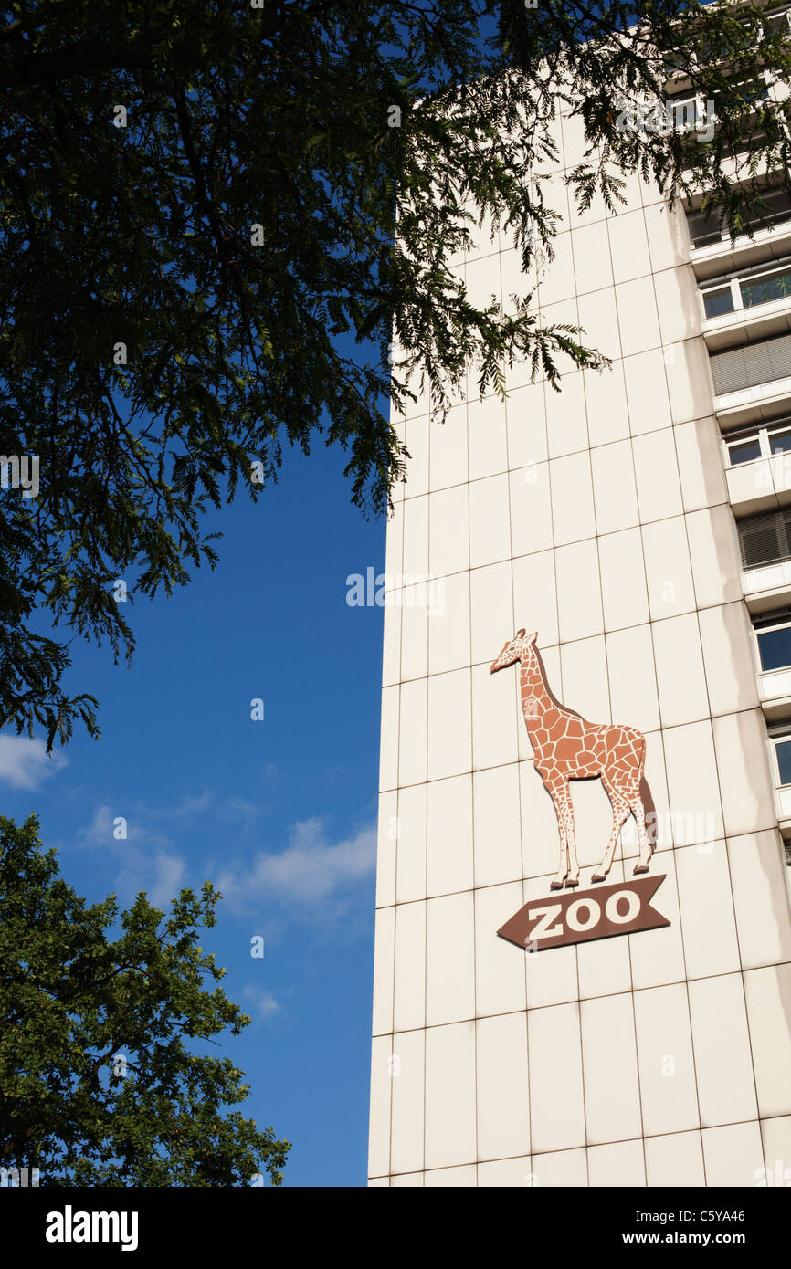 A giraffe sign outside of Zoo Station points to the zoo in Berlin, Germany. - Stock Image