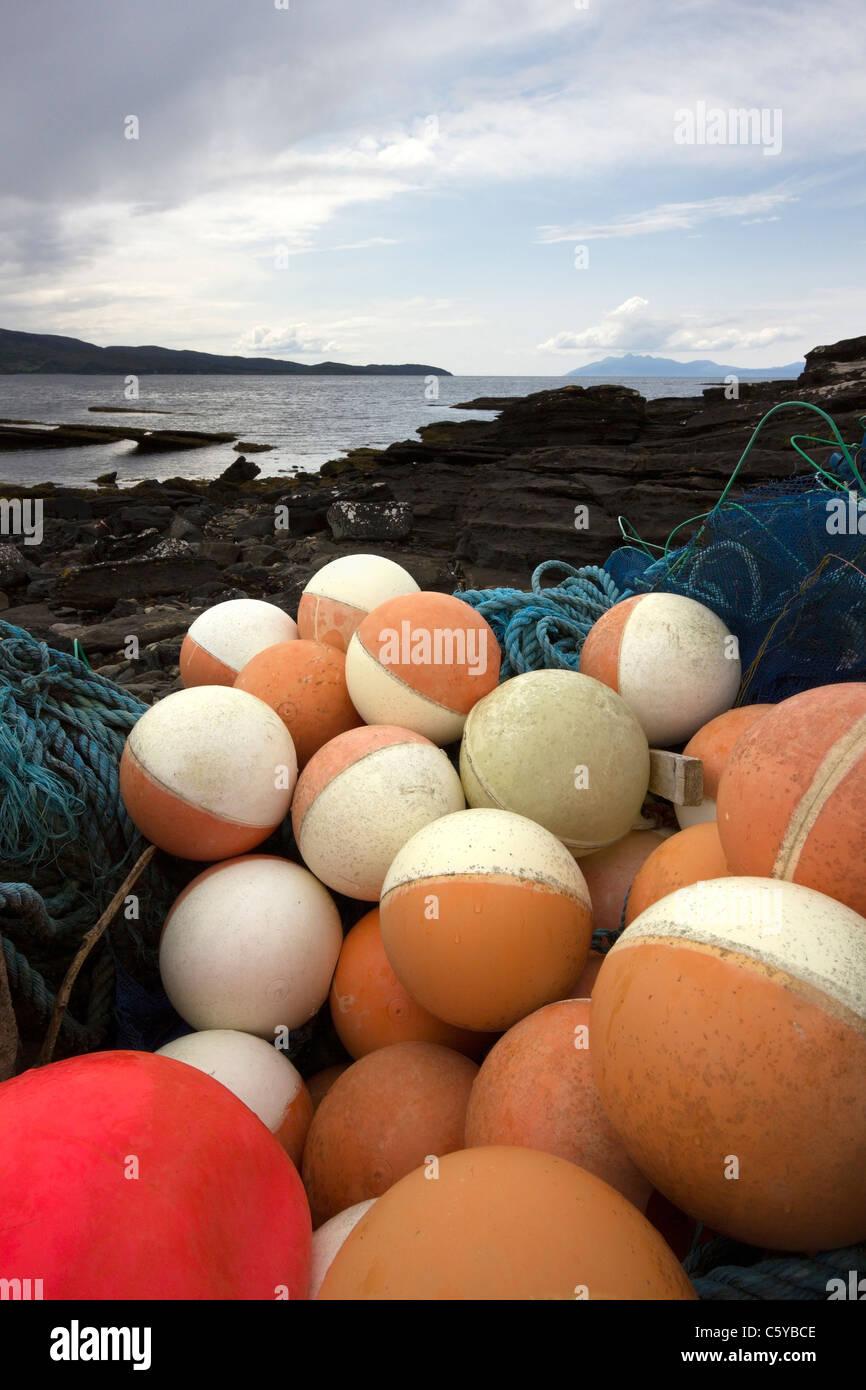 Discarded fishing floats and nets washed ashore on the Isle of Skye, Scotland, UK - Stock Image