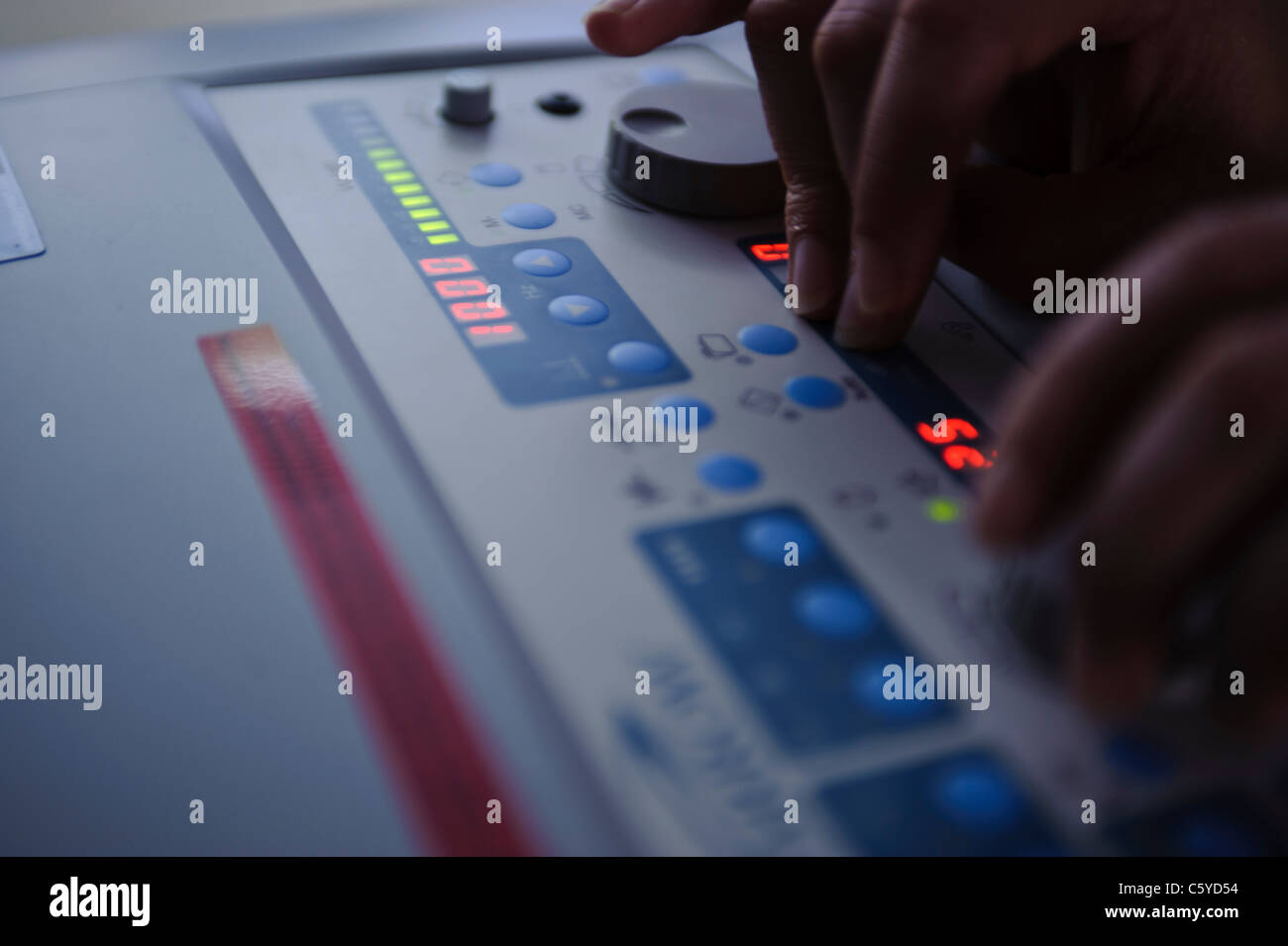 close up of audiology and deafness sound booth control panel with digital readout and knobs - Stock Image