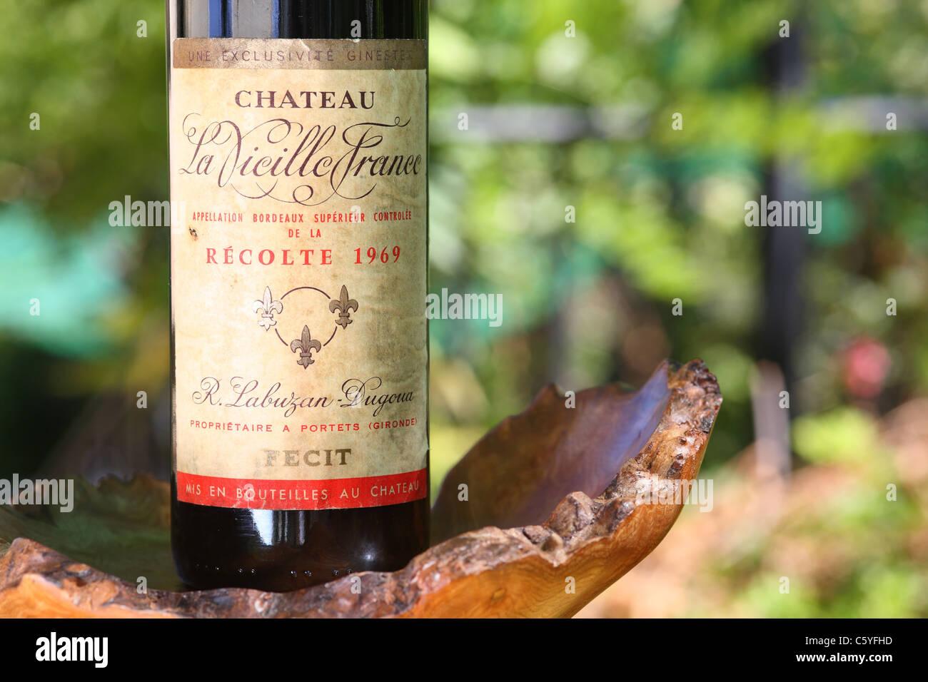 Old Bordeaux wine bottle - Stock Image