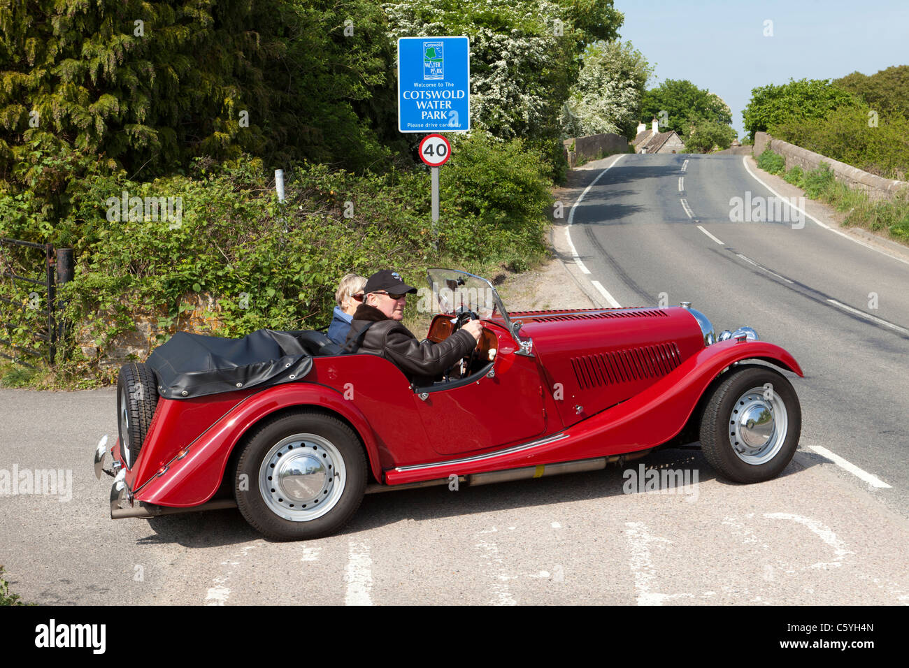 Morgan sports car at the entry to the Cotswold Water Park at St John's Bridge over the River Thames at Lechlade, - Stock Image