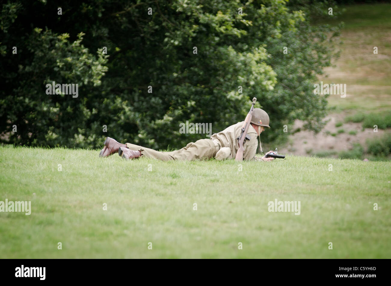 re-enactment WWII American soldiers in Battle - Stock Image