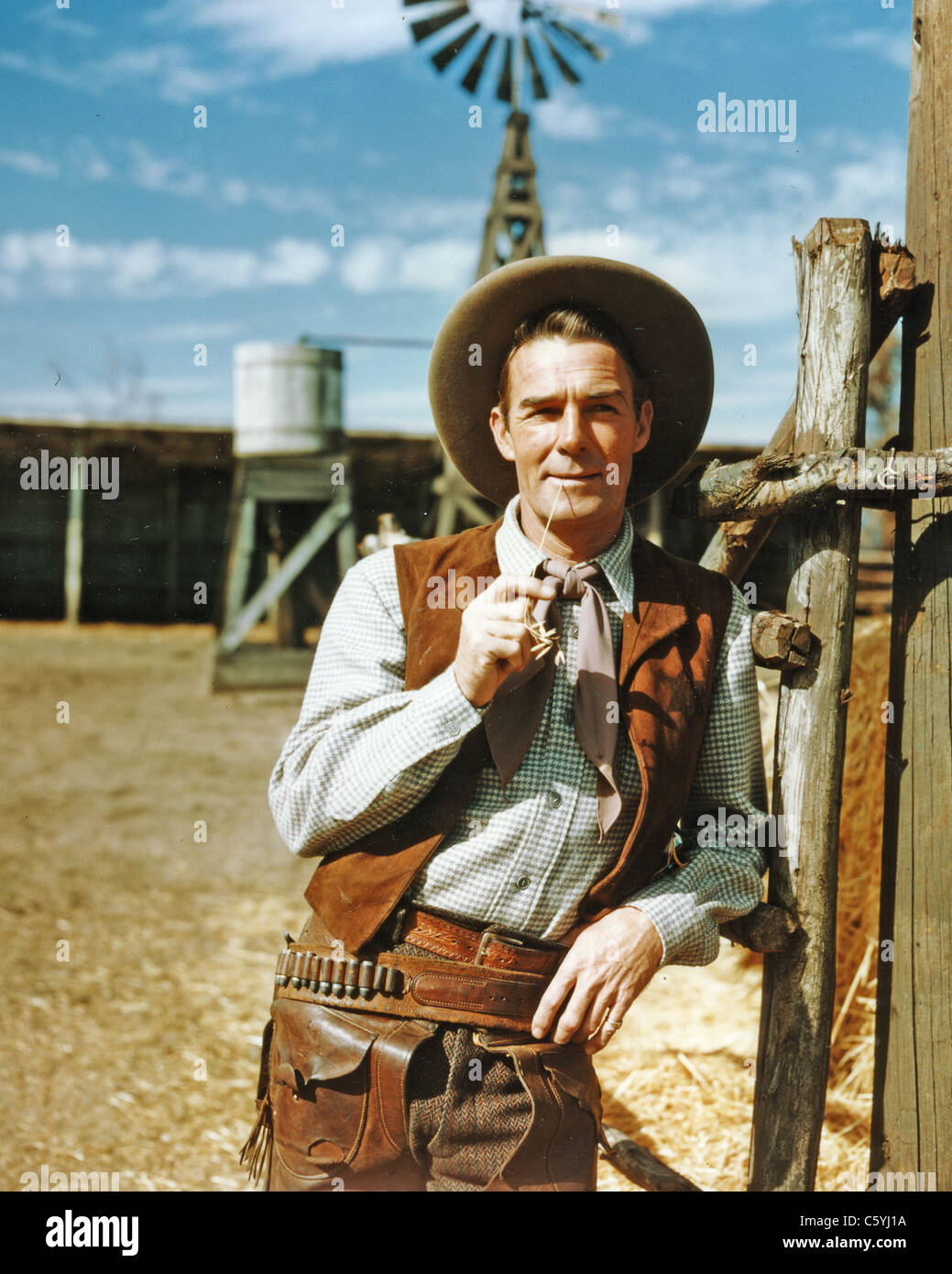 RANDOLPH SCOTT (1898-1987) US film actor in a Western film about 1950 - Stock Image