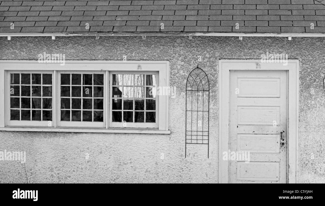 The side of a garage displays interesting geometric shapes. - Stock Image