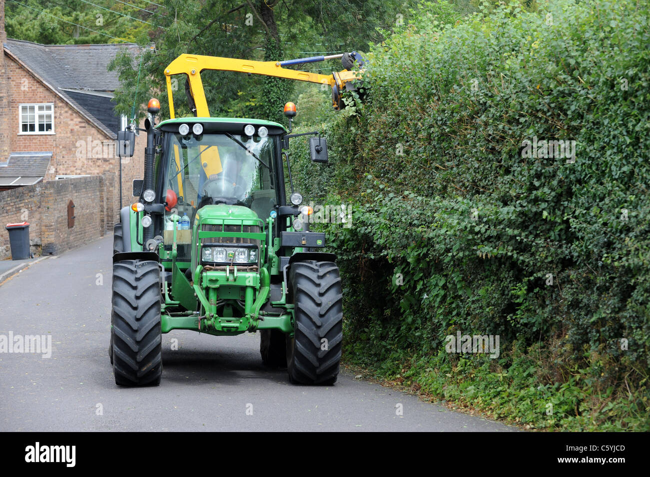 Tractor with hedge cutter uk - Stock Image
