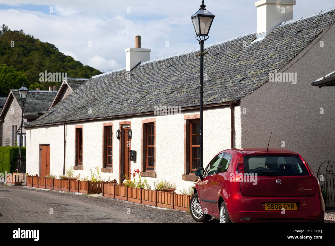 House and car in the village, Luss, Argyll & Bute - Stock Image