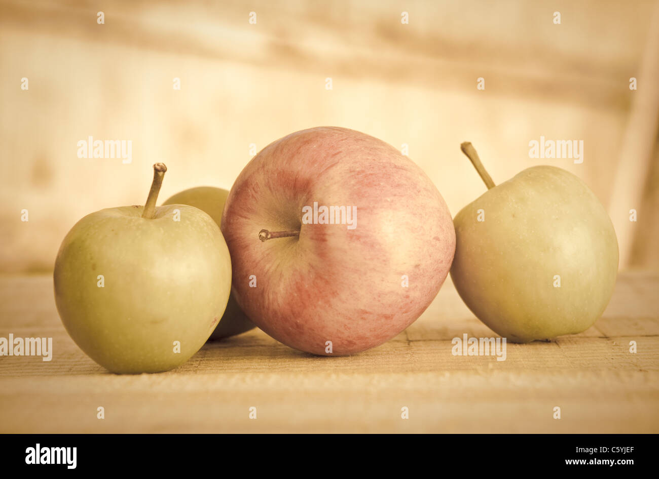 Low contrast still life image of apples - Stock Image