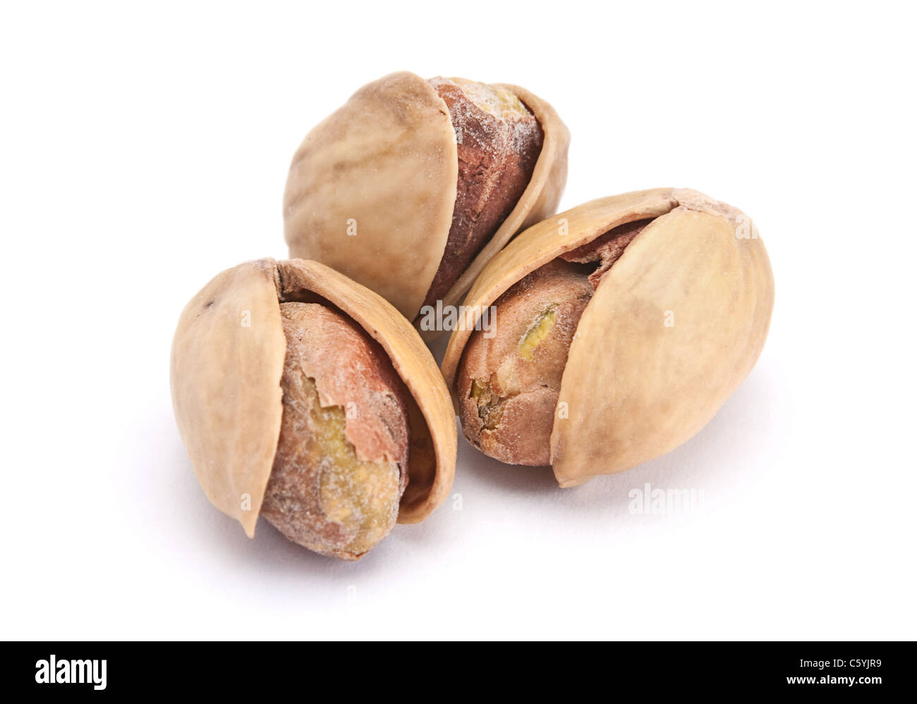 Dry salted pistachio fruit isolated on white background - Stock Image
