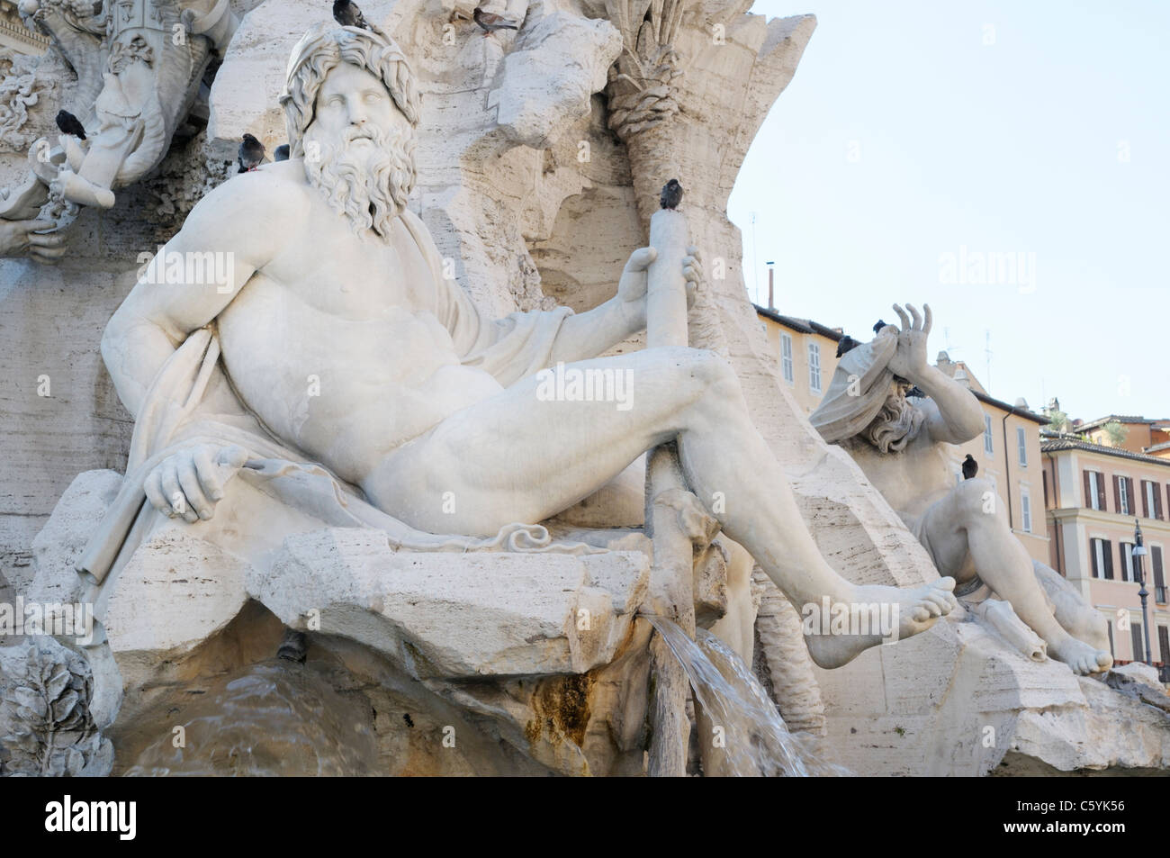 Fountain of the Four Rivers by Bernini,  Piazza Navona, Rome.  Detail of the river god Ganges - Stock Image