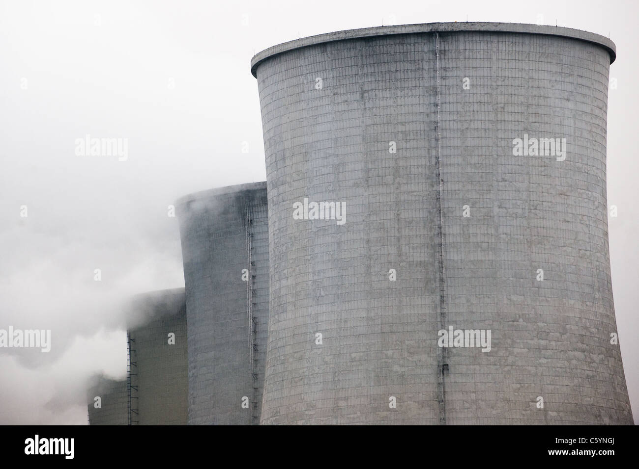Steam smokes from the chimney of nuclear power plant. - Stock Image