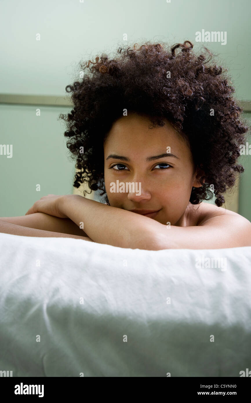 USA, California, Oakland, portrait of young woman lying on massage bed Stock Photo