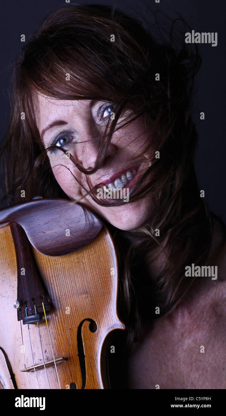 Glamorous violinist - Stock Image