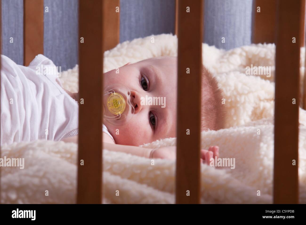 Russia, Voronezh, baby boy (12-17 months) in crib - Stock Image