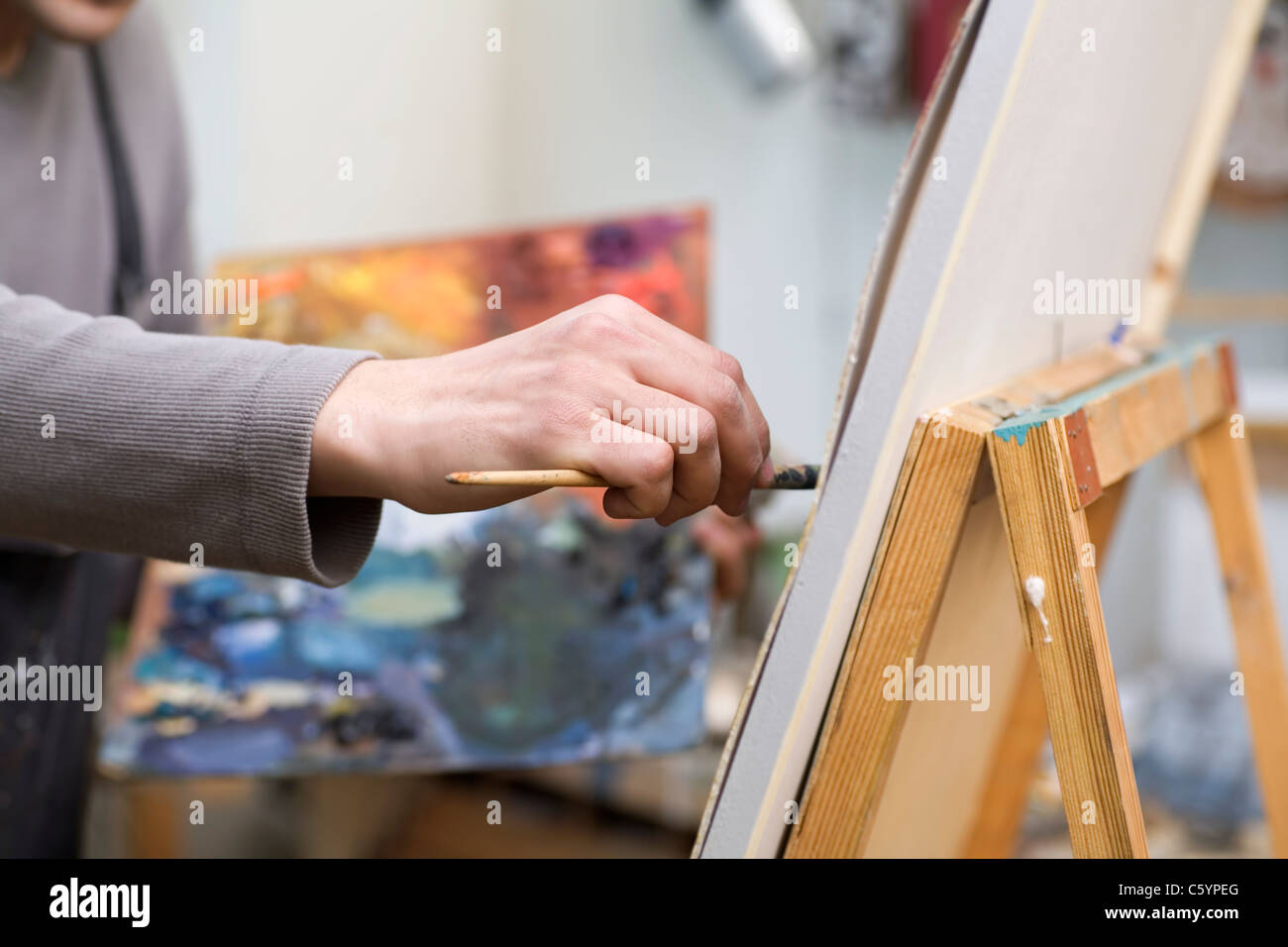 Russia, Voronezh, man painting on canvas - Stock Image