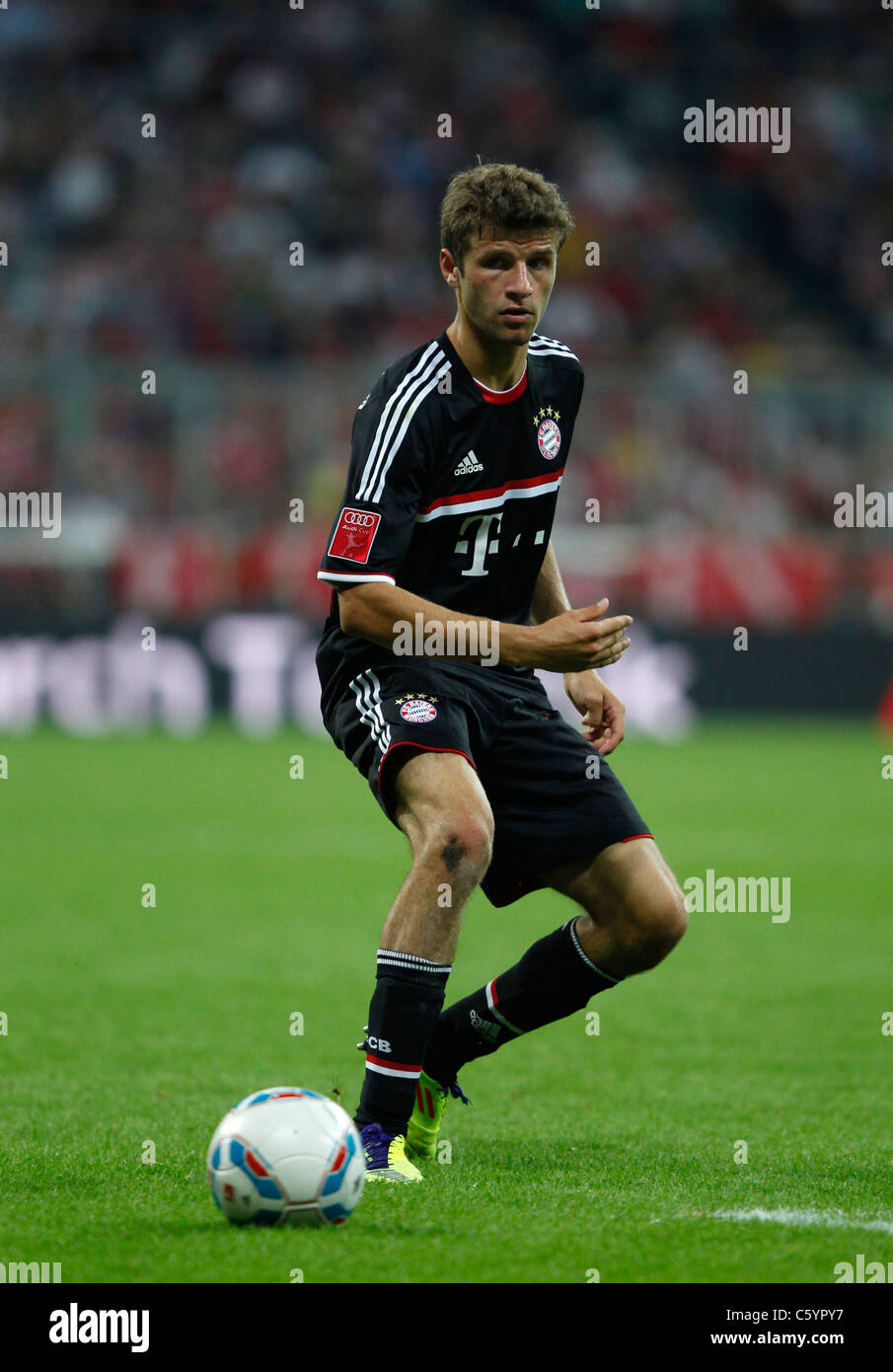 FC Bayern Munich player Thomas Mueller in action. - Stock Image