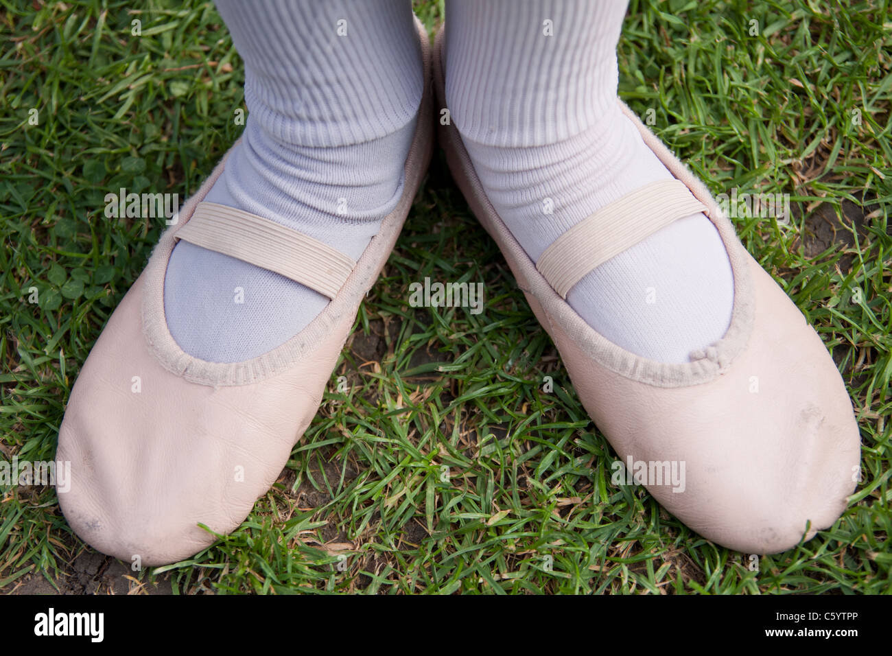Young Girl in Ballet shoes Stock Photo
