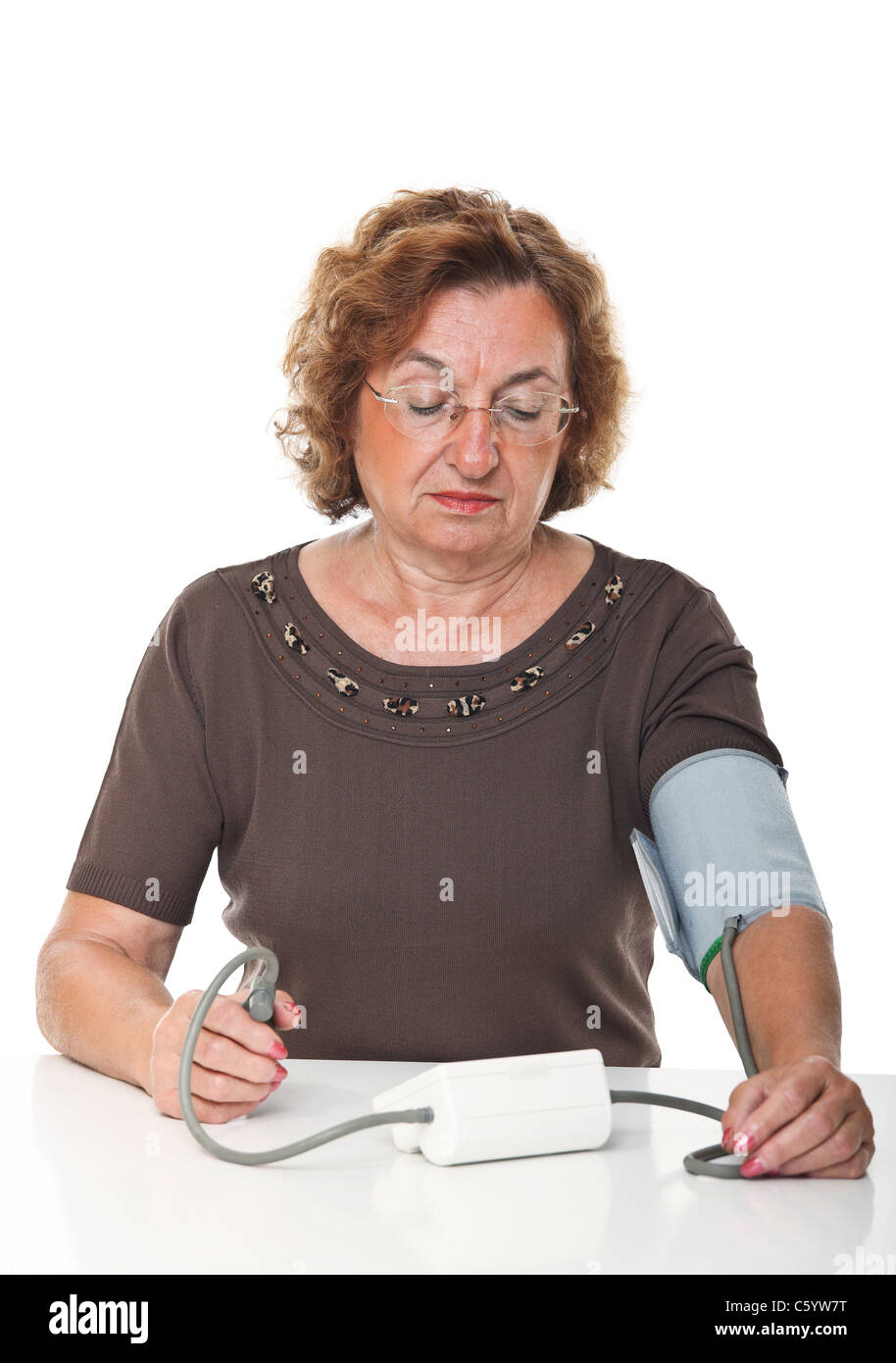 senior woman check her blodd pressure with machine Stock Photo