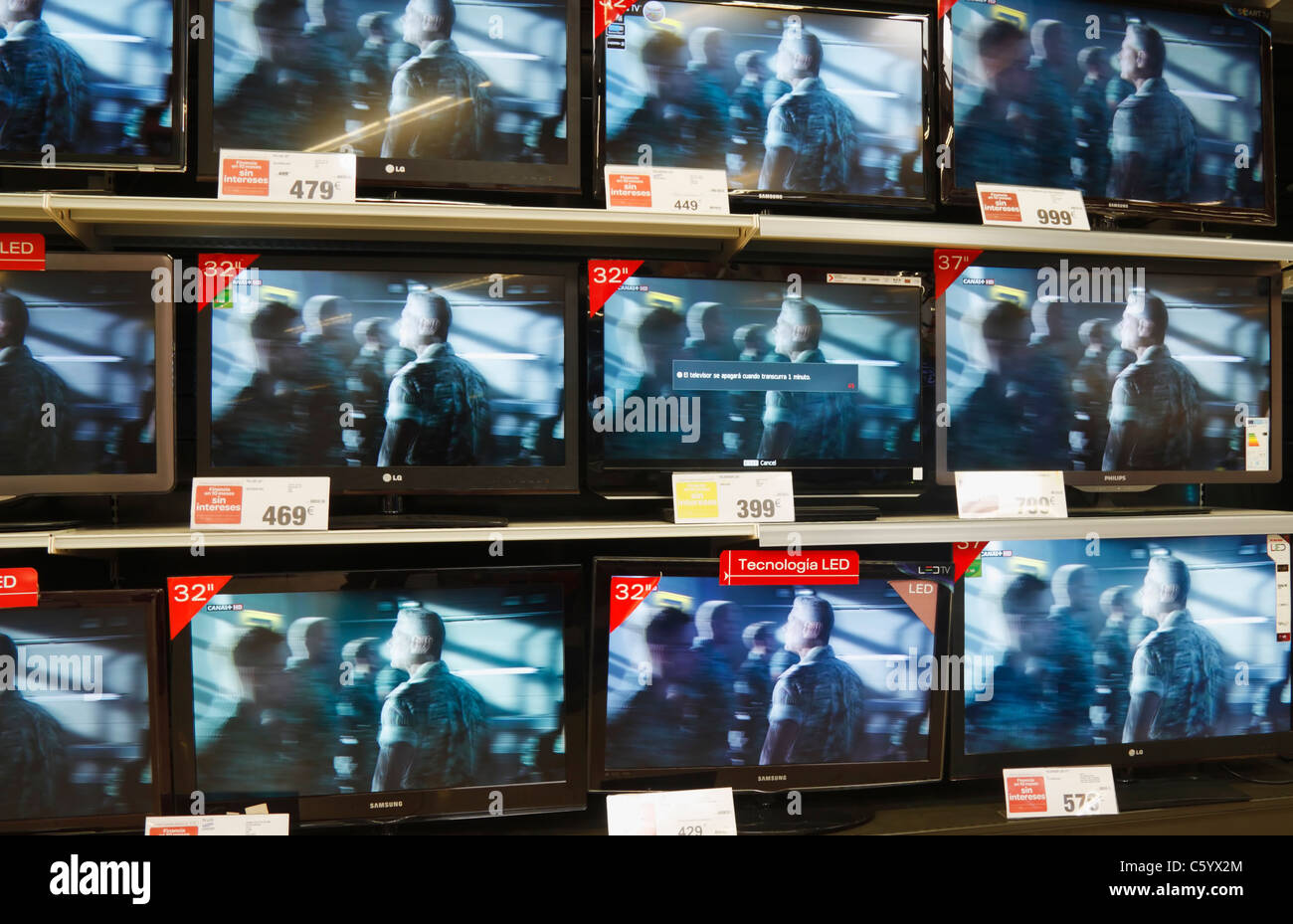 Plasma televisions on display in Carrefour supermarket in Spain - Stock Image