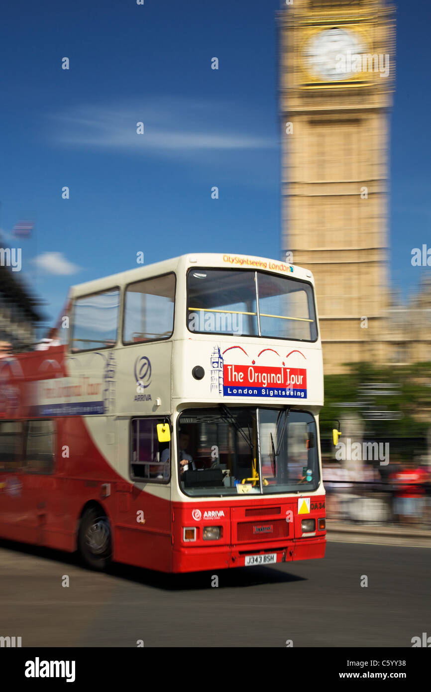 London sightseeing bus passing Big Ben, London - Stock Image