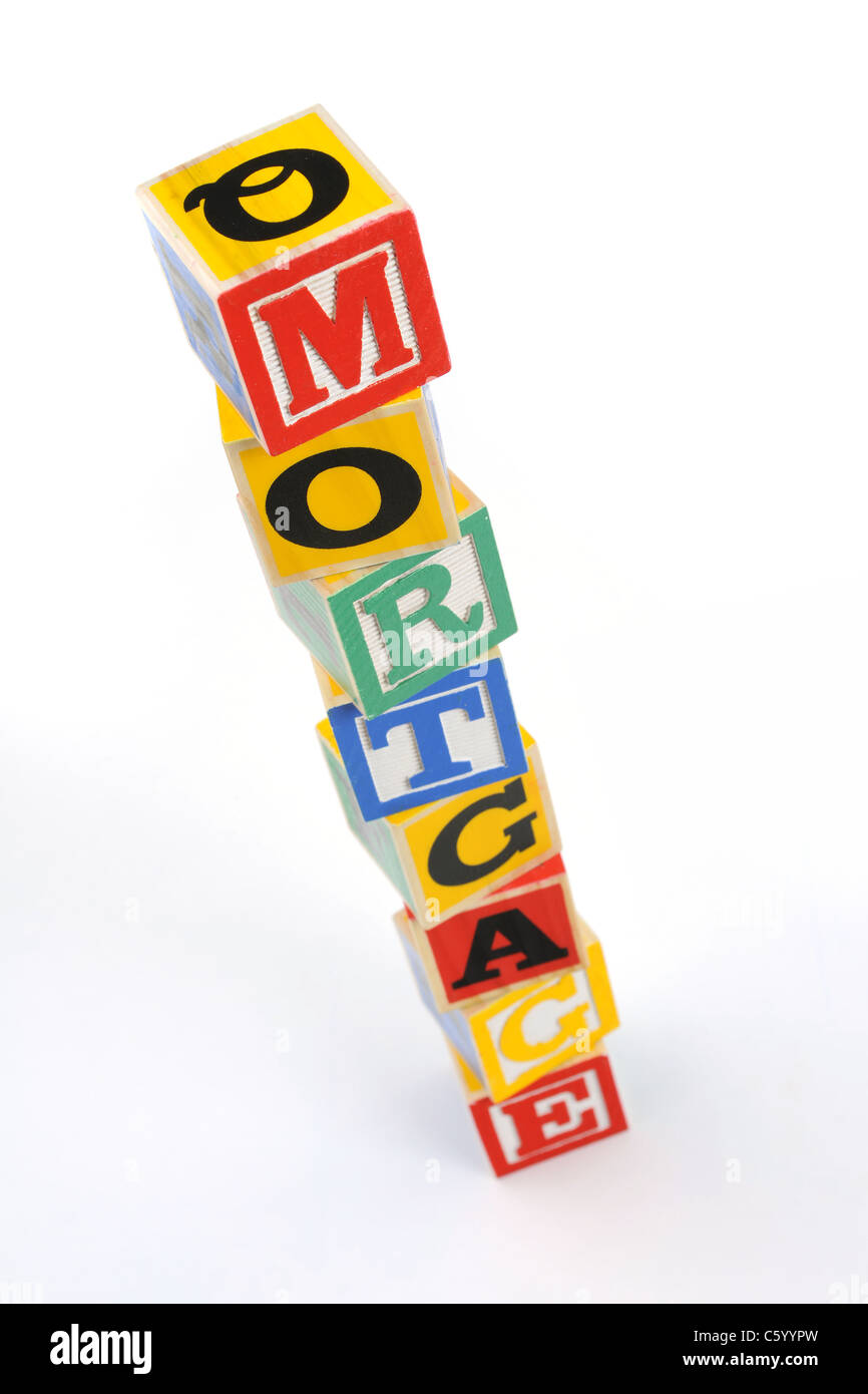 the word 'mortgage spelled with children's letter blocks - Stock Image