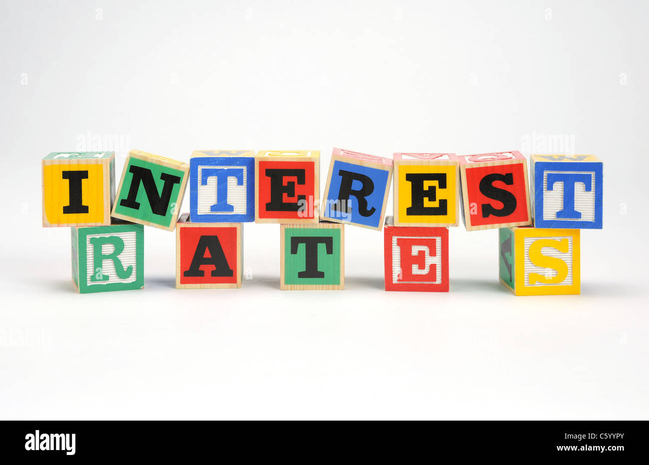 the words 'interest rates' spelled out with children's letter blocks - Stock Image