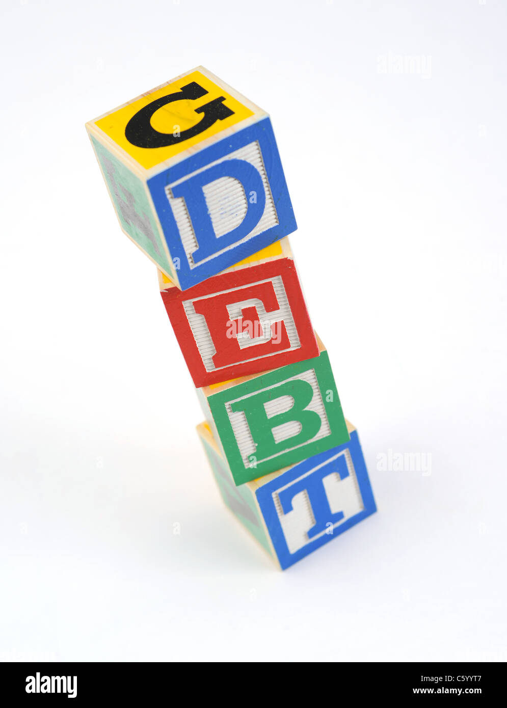 the word 'debt' spelled out with children's letter blocks - Stock Image