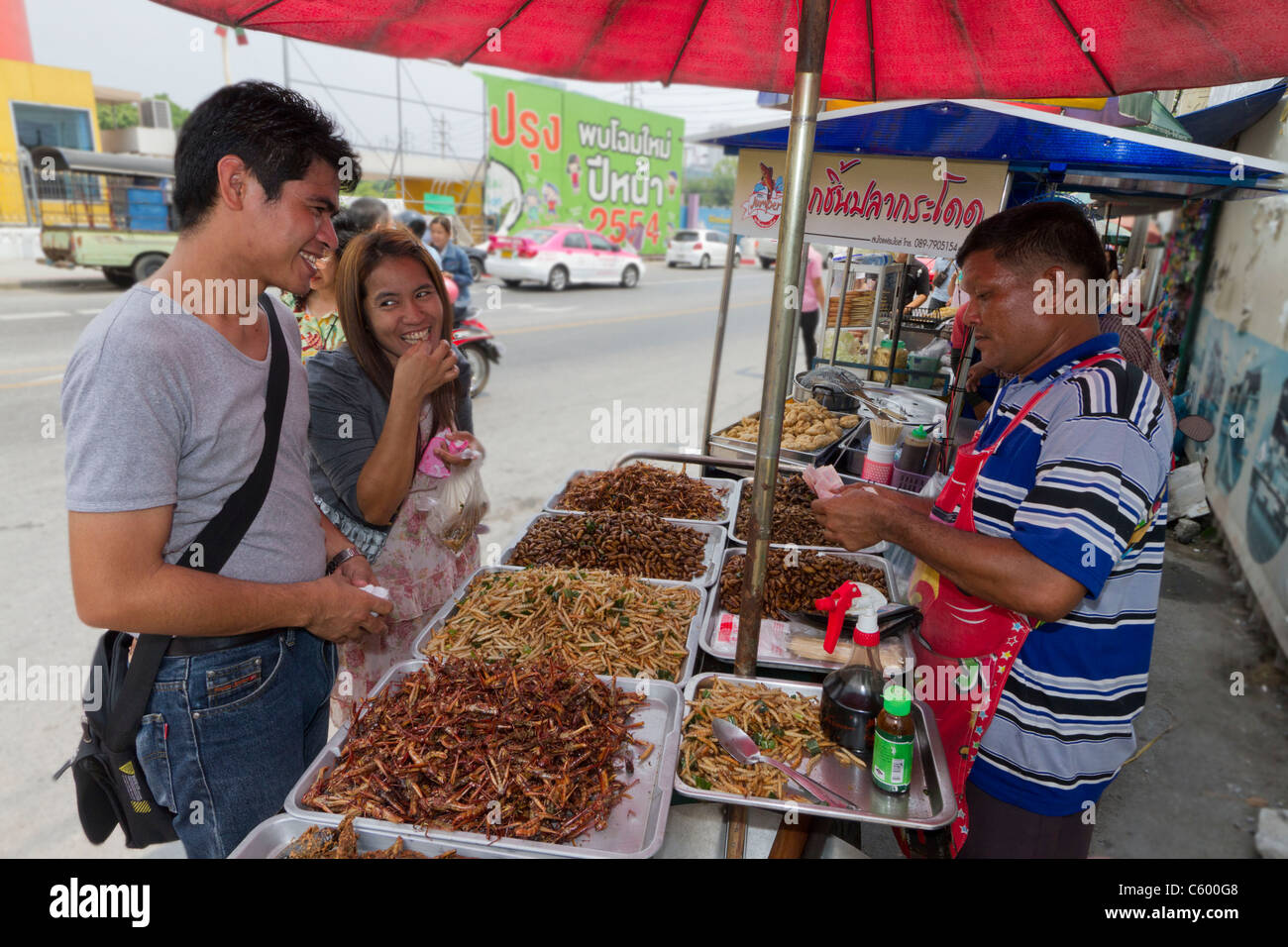Deep fried grashoppers at Chatuchak market stall in Bangkok, Thailand - Stock Image